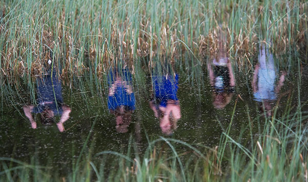 Kids reflection in water